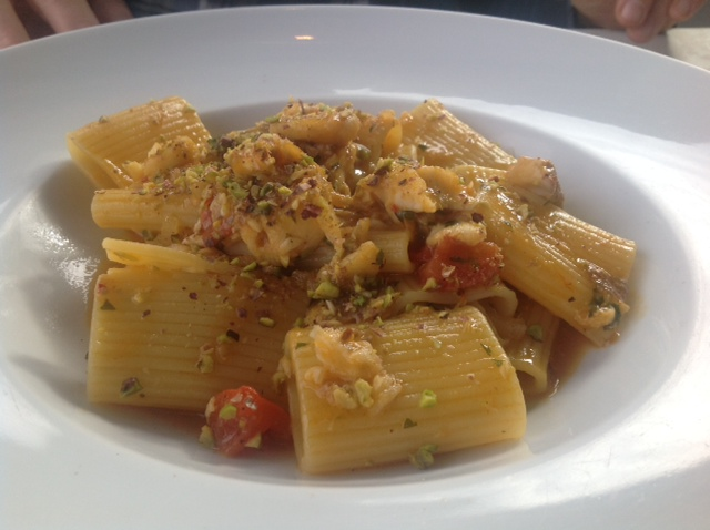 A recipe by Salvatore: Mezzi Paccheri Rigati with Amberjack, tomatoes and pistachios